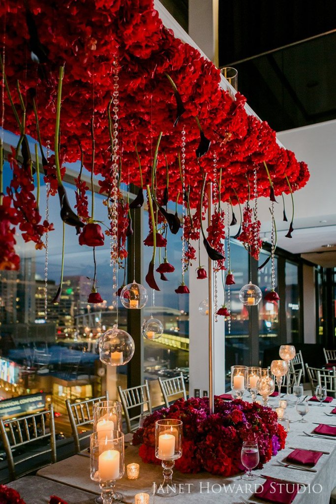 Red floral hanging centerpiece by Edge Design Group