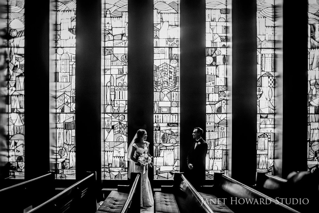Bride and Groom with Stained Glass windows
