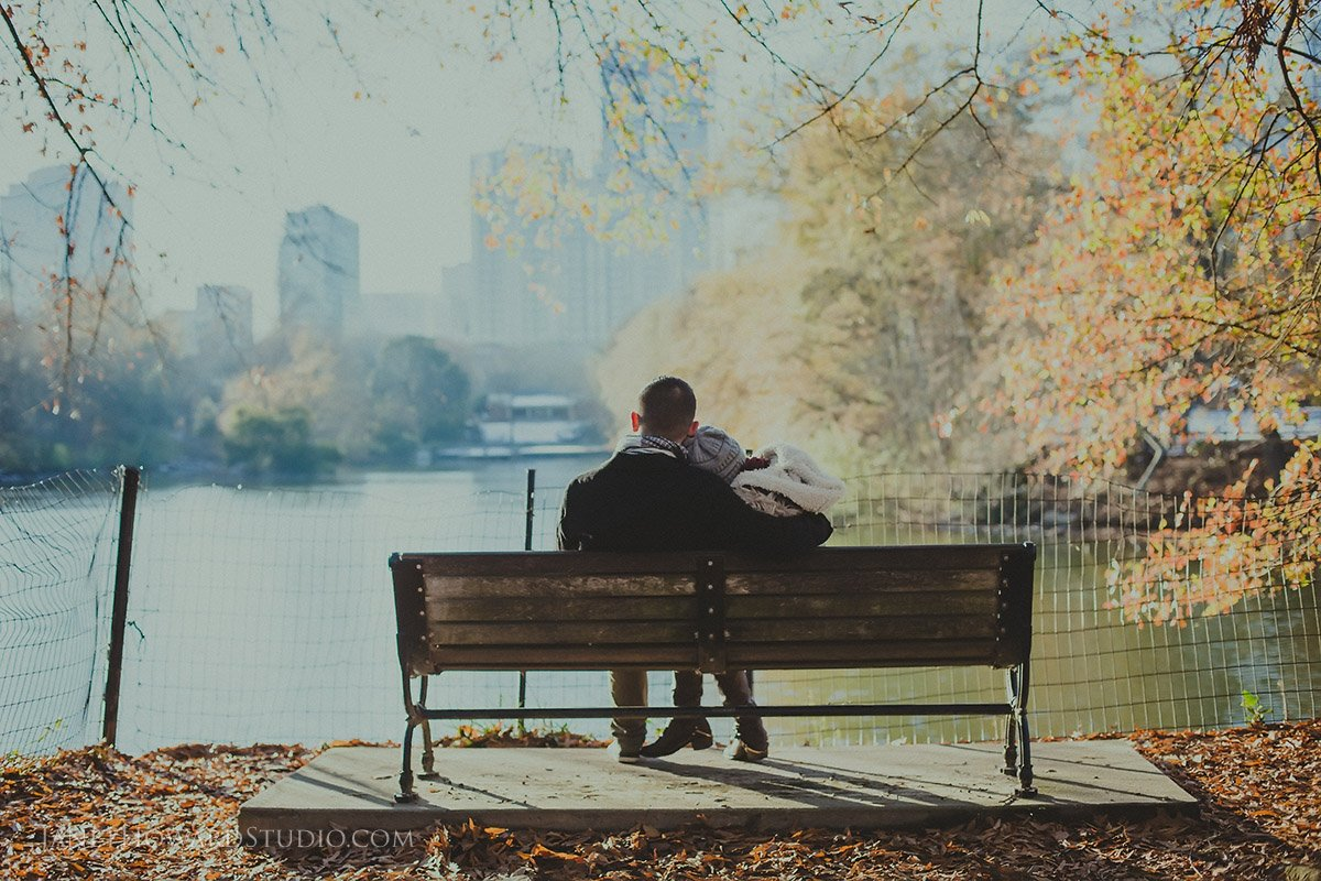 Piedmont Park Couple Engagement Photo on a Bench in Front of the Lake