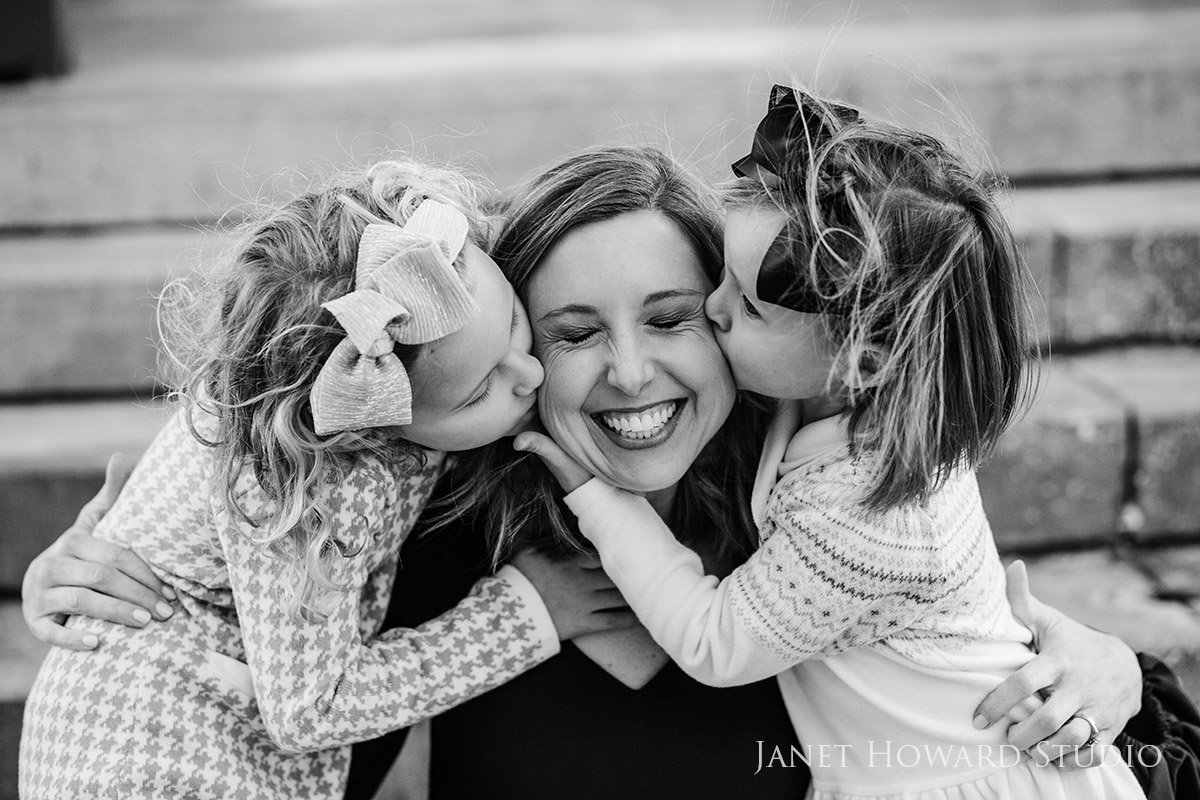 Daughters Kissing Mom
