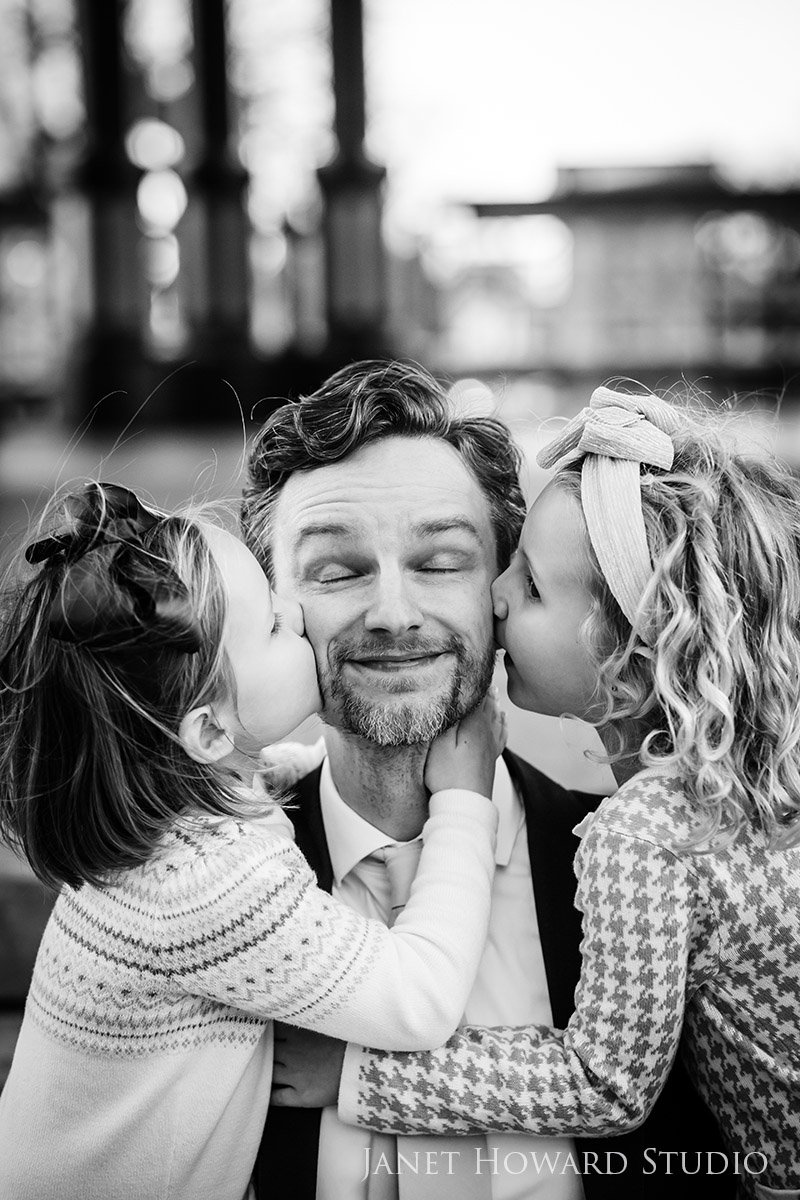 Daughters Kissing Dad