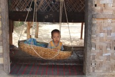 Baby in wicker swing