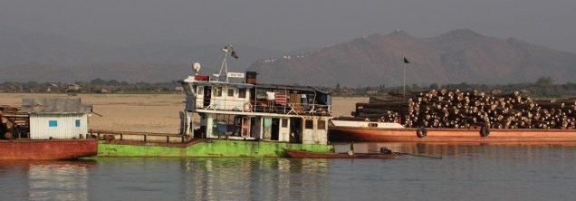 This boat is bringing teak down the river.