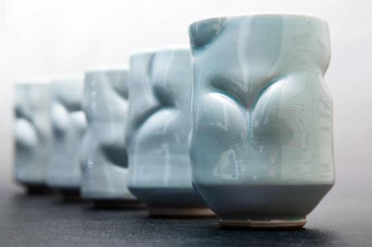Thrown and altered celedon cups