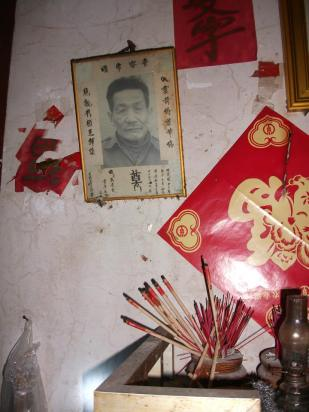 It is an altar for my uncle. He lived a life of poverty as he was left behind in China.
