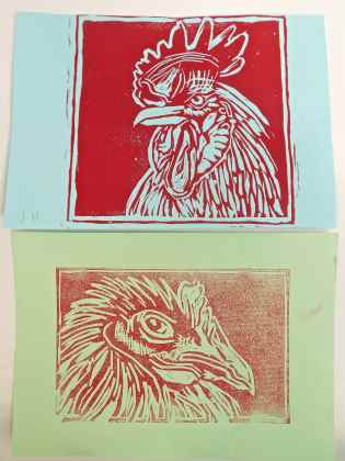 Cockerel linocut on blue paper and young chicken printed on green paper.