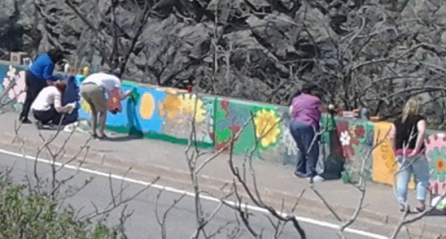 Volunteers painting a concrete barricade wall in Saint John, NB, May 2015