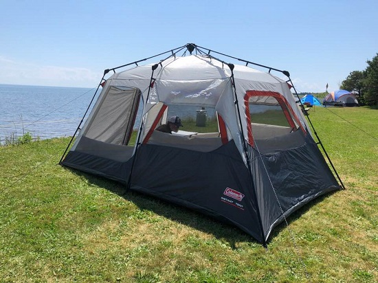 "Tend, with caption: ""This would be our first campsite on PEI. Yep, that's the Atlantic outside our front door."""