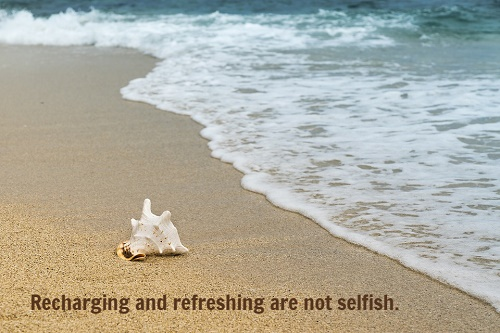 "Seashore with text: ""Recharging and refreshing are not selfish."""