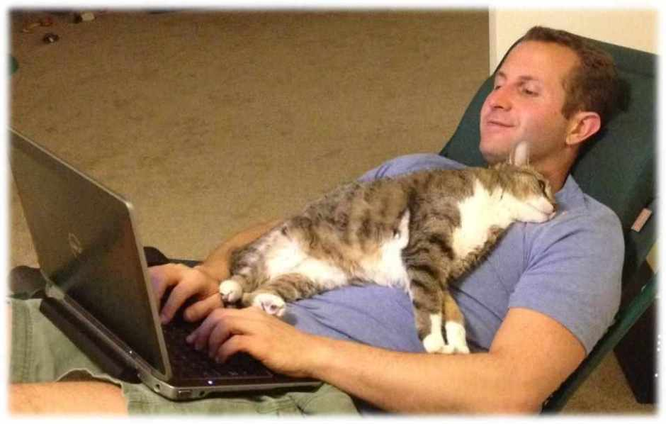 Paul Shapiro with laptop and cat