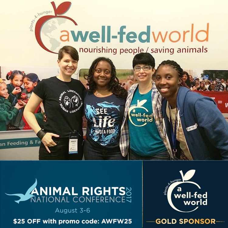 A Well-Fed World Booth with Staff