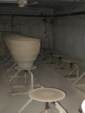 a row of drying pots