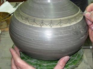 Giorgios decorating a pot