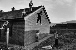 With nothing else to do these children spend their holidays jumping off the roof of a derelict house. One of the older boys asked me, 'What religion are you?' his expression at once questioning and threatening. 'Atheist,' I answered. 'Is that Catholic atheist or Protestant atheist?'