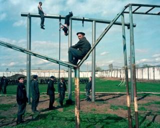 "Krasnoyarsk region. Town of Reshoti (500 km from Krasnoyarsk). Former Gulags turned into prison camps. Youth camp (14-18 year old boys). Project ""Zona""."