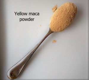 spoon full of yellow maca powder