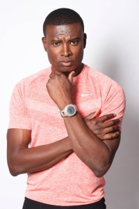Black man in athletic shirt looking confused
