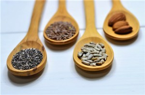 Wooden spoons holding seeds and nuts, important elements of the Mediterranean Diet