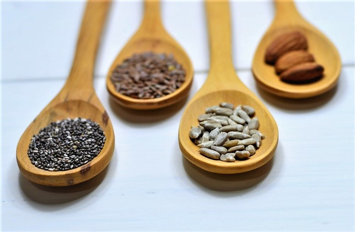 Wooden spoons containing seeds and grains to show important elements of the Mediterranean Diet