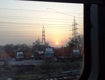 We watched the sun rise from the train