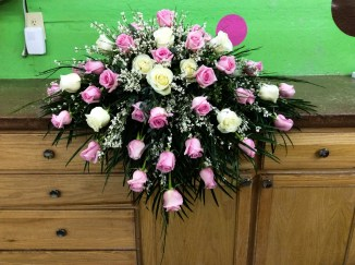 $365, as shown. Other color roses available.