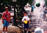 Brandon & Chad playing in fountain in Aspen