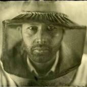 Portrait of Osheen Harruthoonyan (with beekeeper hat).
