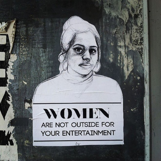"""This photo shows a poster by Tatyana Fazlalizadeh, with a drawing of a young woman's head and shoulders over the message, """"Women are not outside for your entertainment."""""""