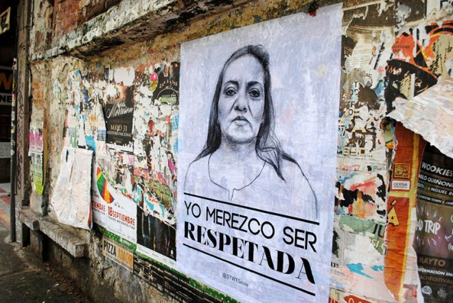 "This photo shows a poster by Tatyana Fazlalizadeh, which has been placed on a public wall over a colorful mix of the scraps of earlier posters. Tatyana's poster shows the head and shoulders of a young woman, over the message ""Yo Merezco Ser Respetada,"" which is Spanish for ""I deserve your respect."""