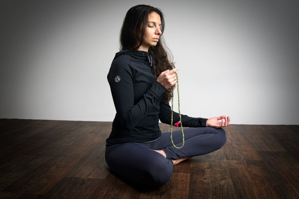 buddhist meditating with mala beads