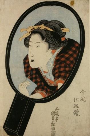 Woman Blackening Teeth