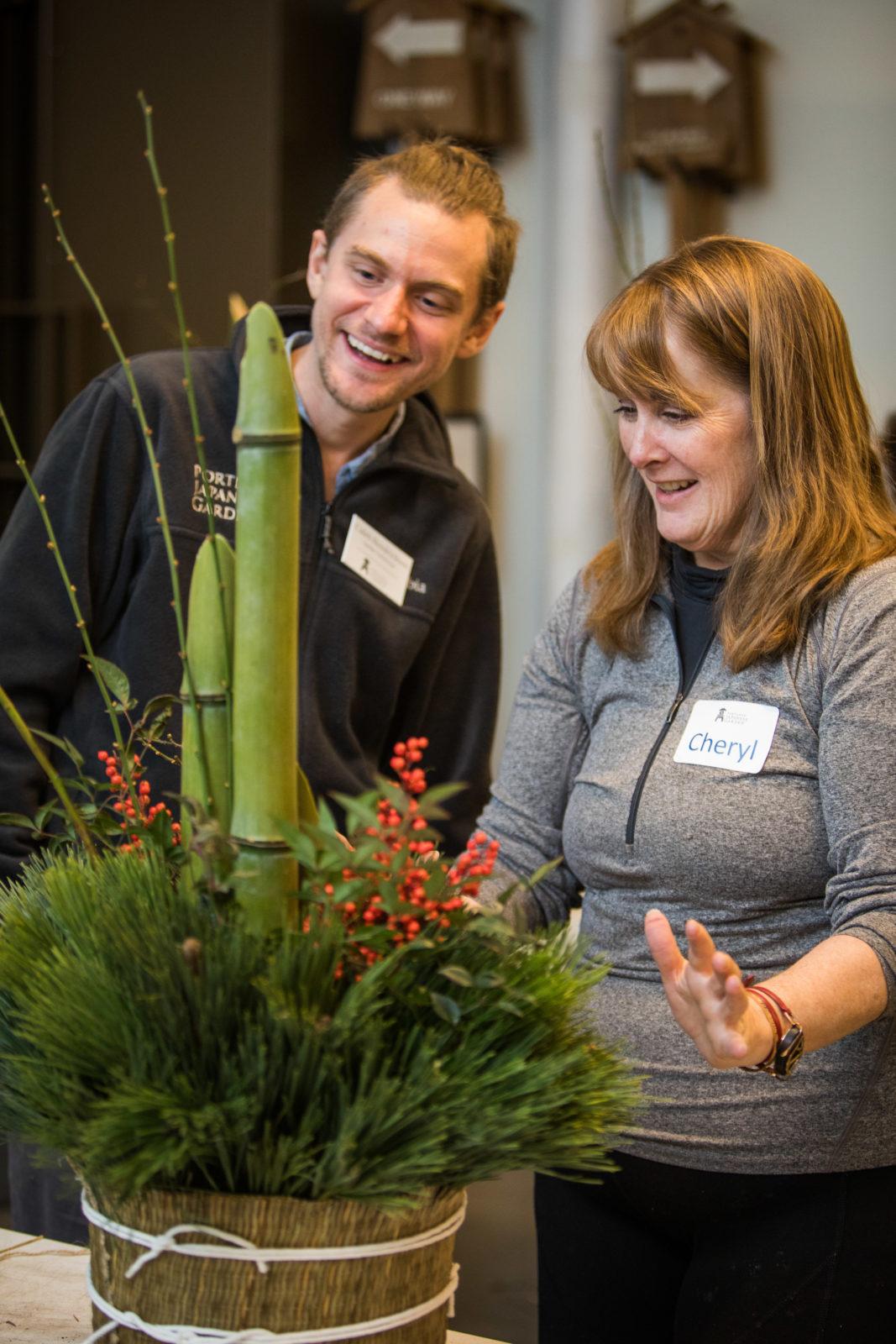Gardener and student smile at kadomatsu creation