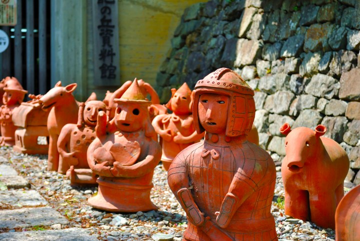 """Haniwa"" (the ""hani"" means ""read clay"") are ancient pottery or modern pottery done in the ancient style made of, yup, red clay."