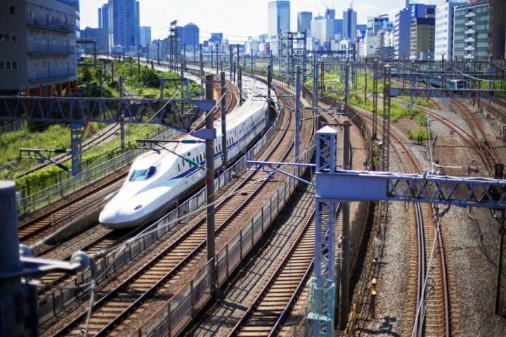 A shinkansen rolling under Fuda no Tsuji Bridge.
