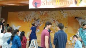Yuvas helped put up the backdrop, as well decorate and offer prasad.