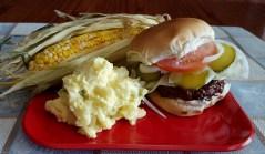 Grilled Hamburger with Corn on the cob and Potato Salad