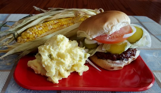 Grilled Hamburger with Corn on the cob and Potato Salad