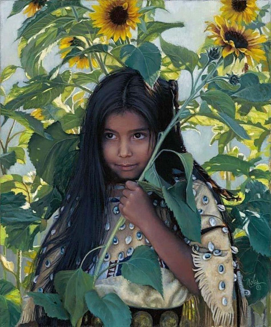 Fille autochtone en costume avec tournesol