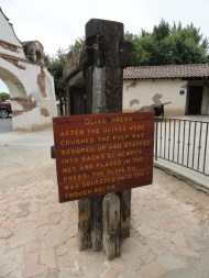the olive press sign
