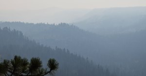 Wildfire smoke in a mountain valley