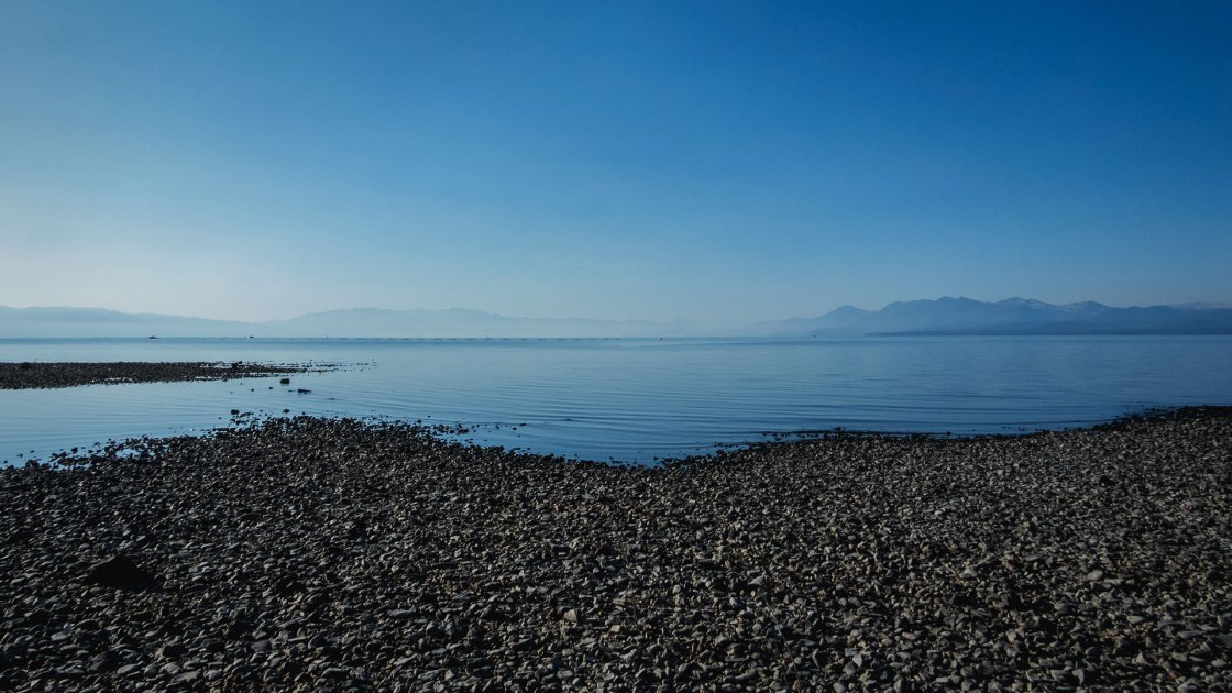 Rocky beach with blue water and sky