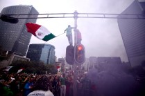 Paseo De La Reforma; Mexico City after Mexico's 3-1 victory over Croatia in the 2014 Fifa World Cup. People came from all around the city to dance and sing around Angel of Independence; the epicentre of the celebrations that continued into the evening. © Jared O'Sullivan 23/June/2014
