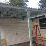 Putting on the new polycarbonate roofing.