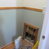 Put in a small door for plumbing