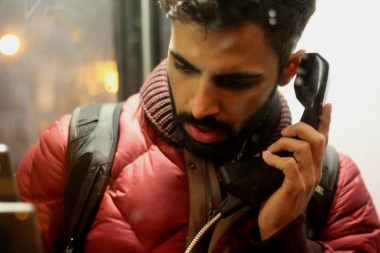 A man in a London phone booth
