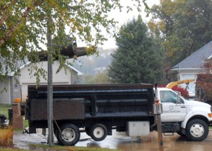 The large logs were loaded into the bed of this truck to be hauled away.