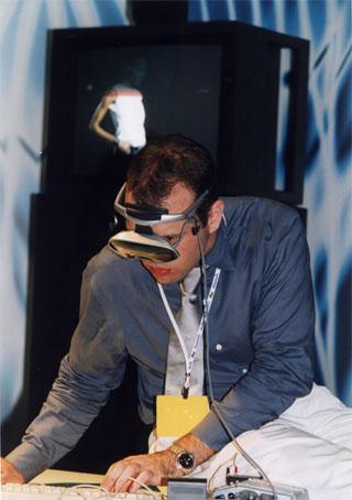 Jarrell Pair using CharmIT wearable computer at Internet World Tel Aviv, 2000