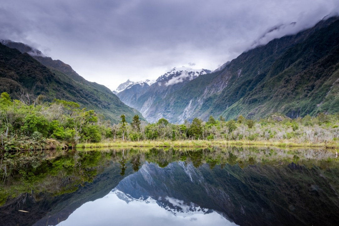 Mountain reflections on Peter's Lake in New Zealand