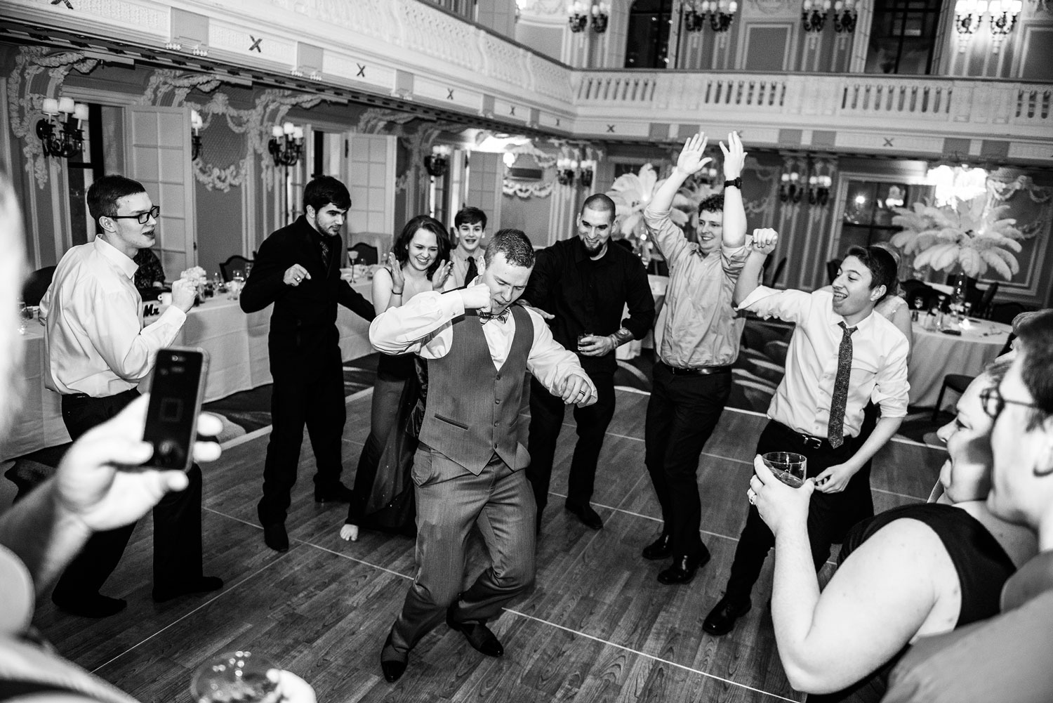 Groom dancing at his wedding ceremony in Chicago's Blackstone Hotel
