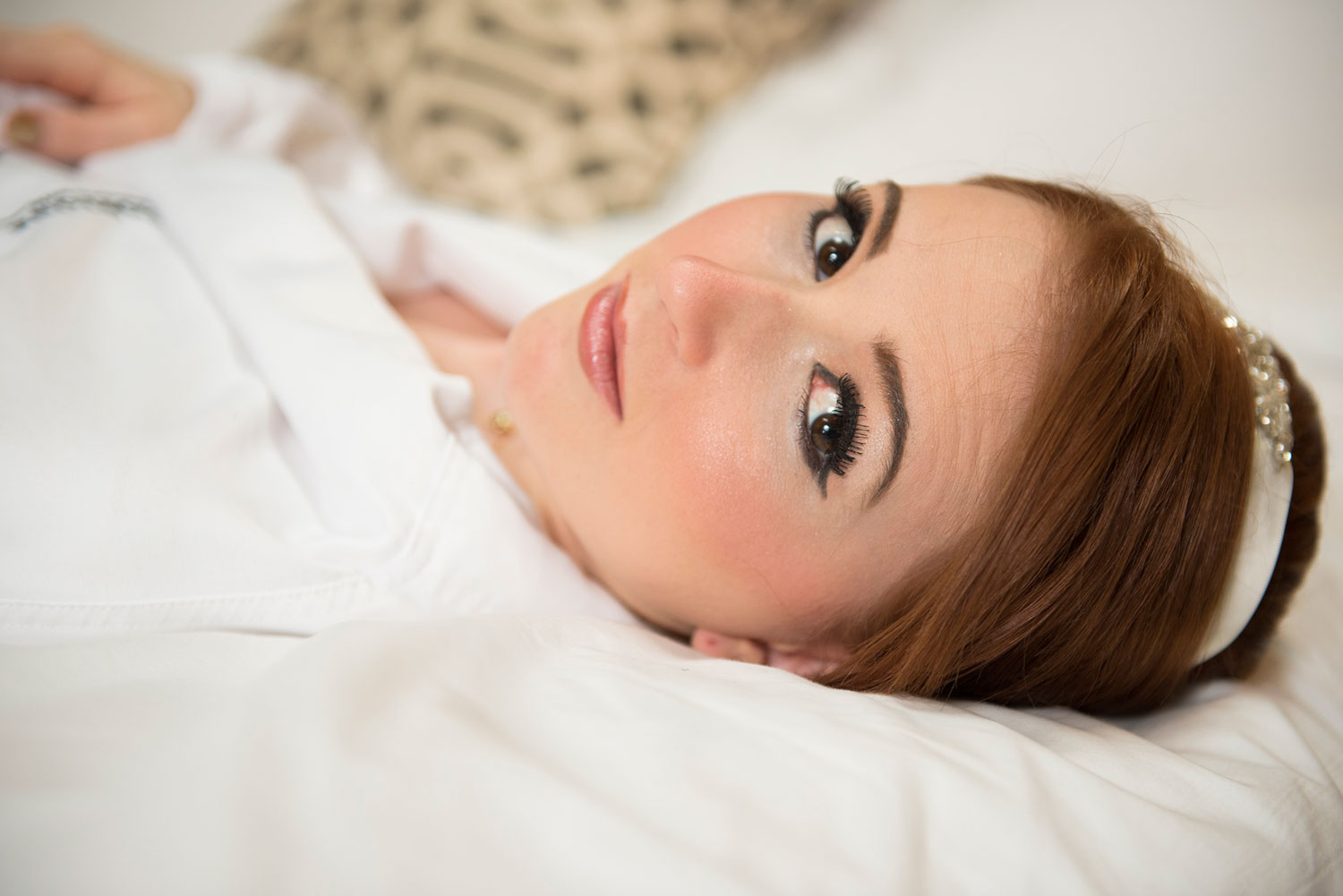 Portrait of a bride laying on her Hotel Bad in Chicago